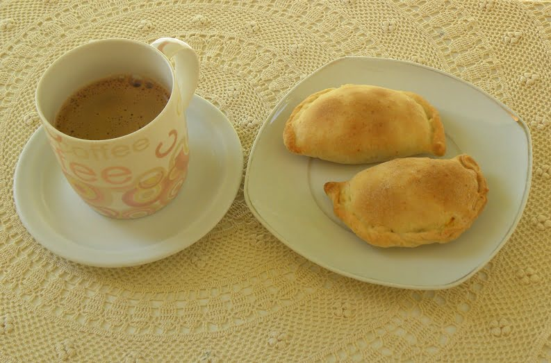 Kolokotes with a cup of coffee image