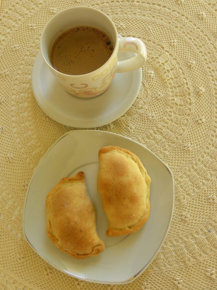 Kolokotes with a cup of coffee picture