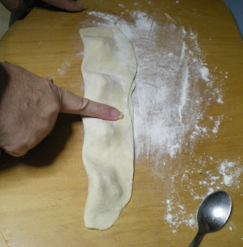 Pressing bourekia with finger image