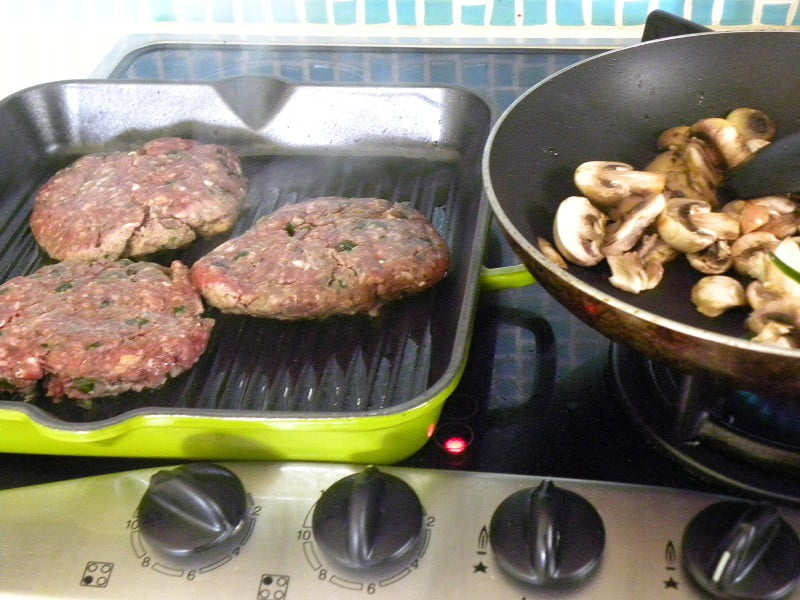 burgers in a cast iron pan image
