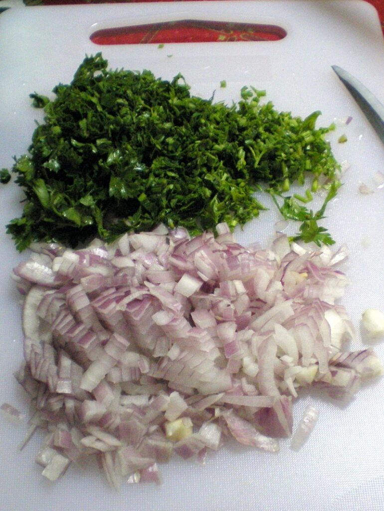 Finely chopped parsley and onion image