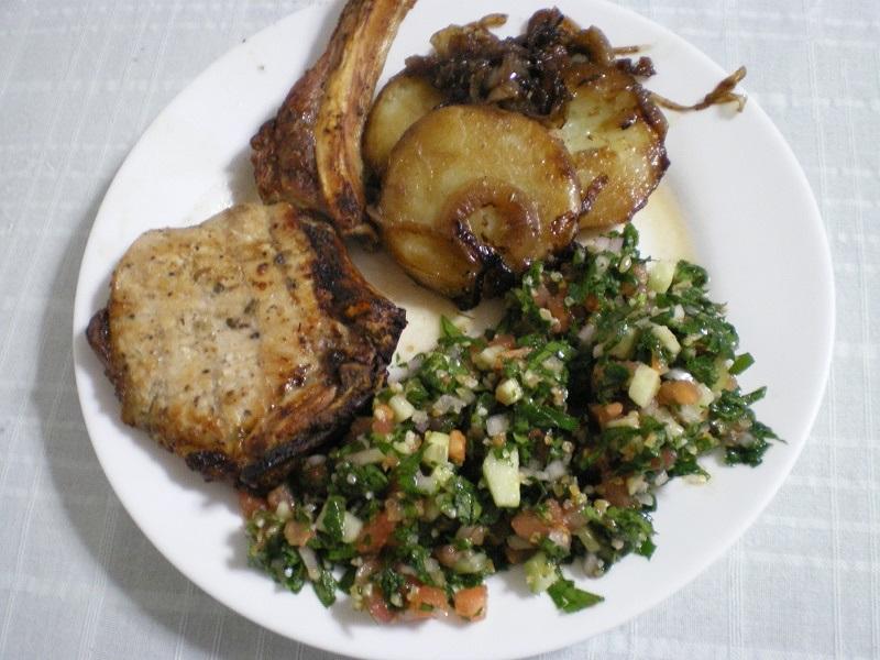 Pork chop served with tambouli image