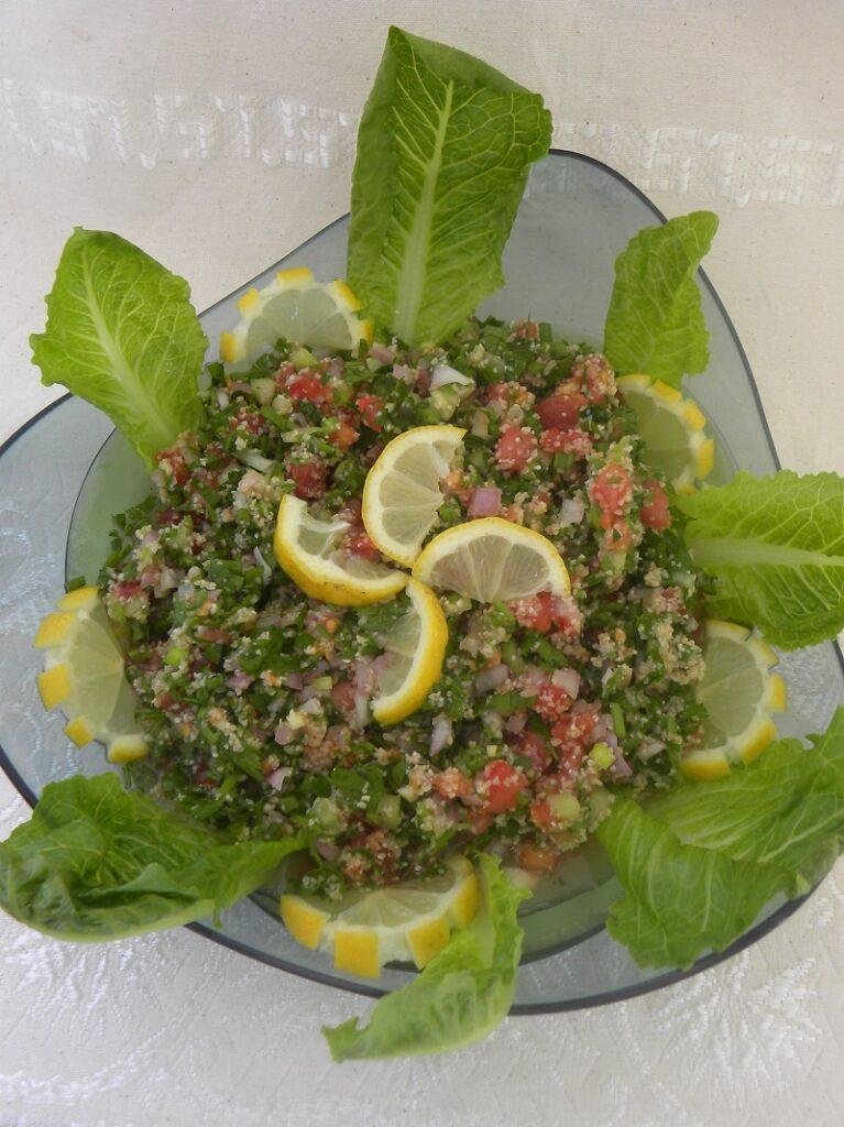 Tambouli with lemon wedges image