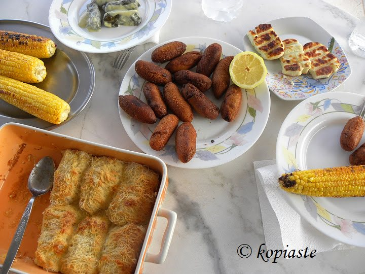 dolmades koupes corn on the cob grilled halloumi image