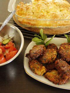 kolokythokeftedes with greek salad and tyropita image