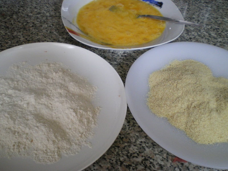 three plates eggs flour breadcrumbs