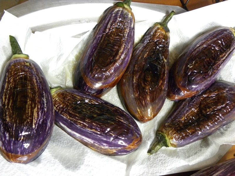 Eggplants fried and draining on kitchen paper image