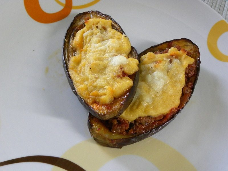Papoutsakia (stuffed eggplants) with bechamel image