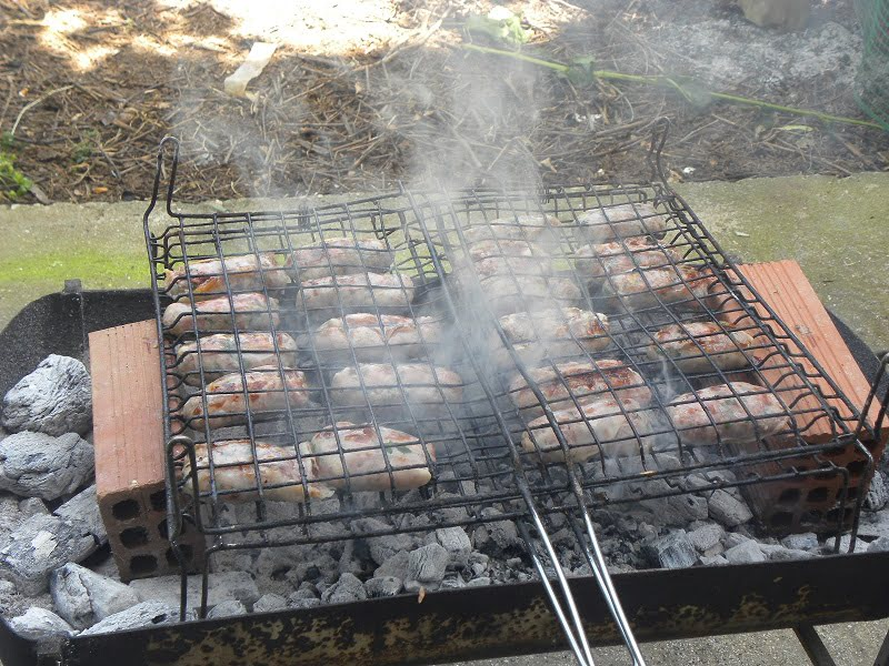 barbecuing sheftalia during Easter image