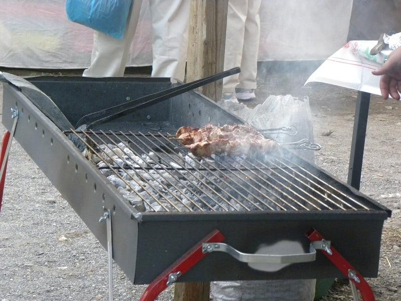 grilling pork souvlakia image