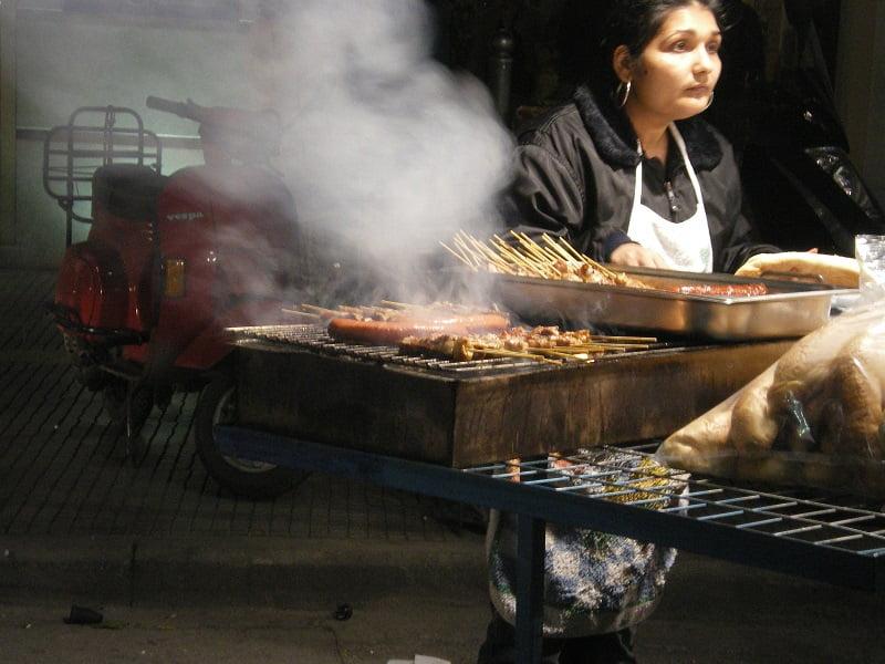 lady selling souvlakia on Tsiknopempti image