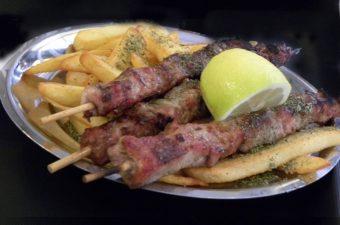 souvlaki with fried potatoes image