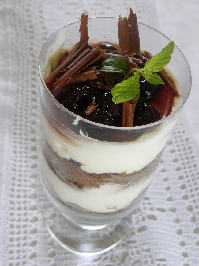 cheesecake with cherries in a glass image