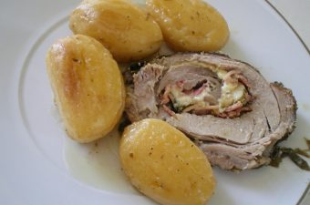 Stuffed pork roast served image