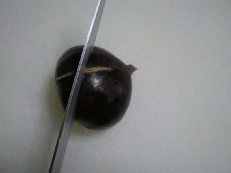 scoring chestnuts crosswise image