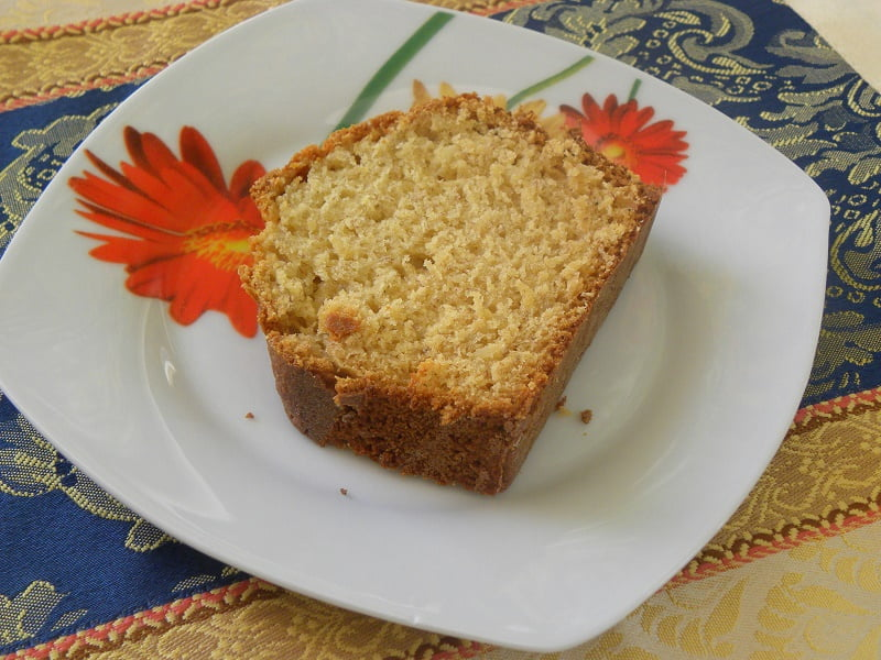 A slice of banana bread in a plate image