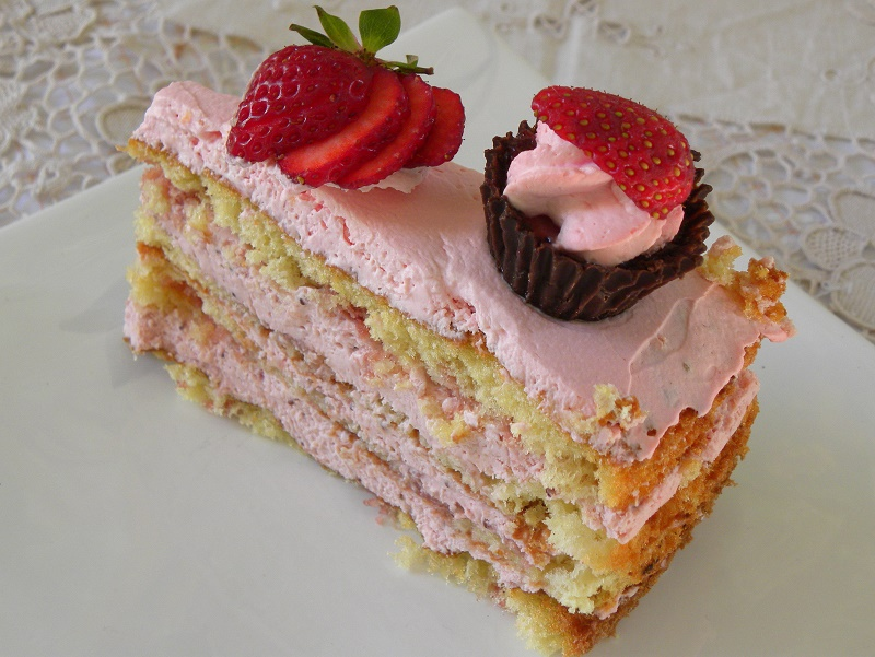 A piece of strawberry mousse cake image