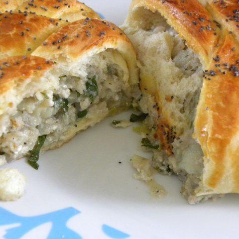 Piroshki with potato baked and cut image