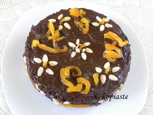 ... chocolate-butter icing, and decorated with almonds. Because of its