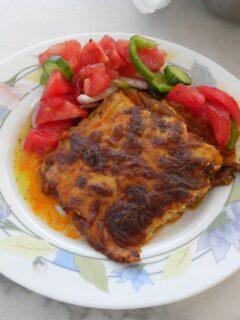 Vegetarian moussakas served with salad image
