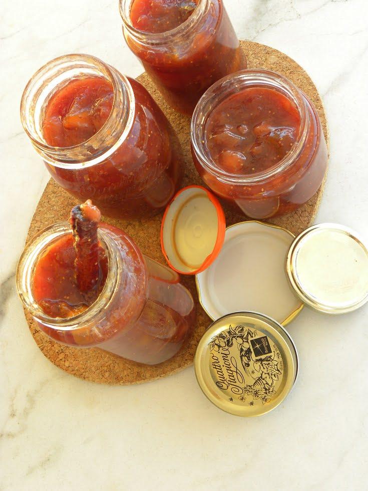 Banana, fig peach and grape jam in jars image