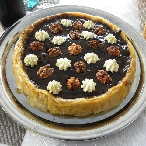 Baklavas tart with whipped cream image