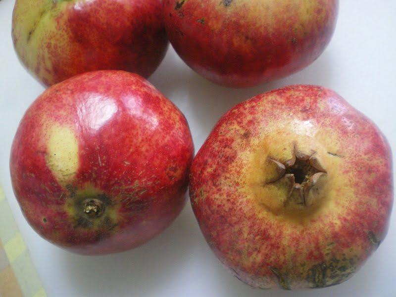 four pomegrantes image