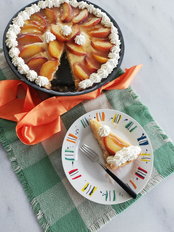 Peach Tarte Tatin with whipped cream photo