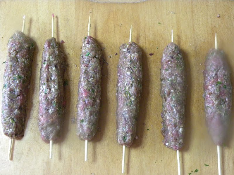 Shaping the kebabs around skewers image