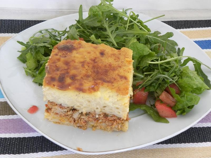 A slice of Pastitsio with salad photo