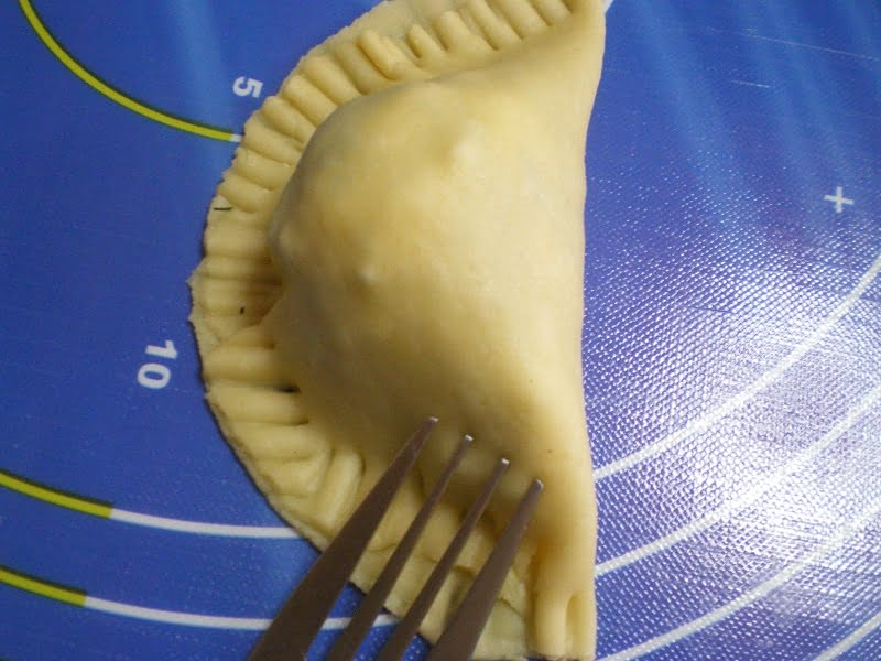 Other turnovers pressed with a fork image