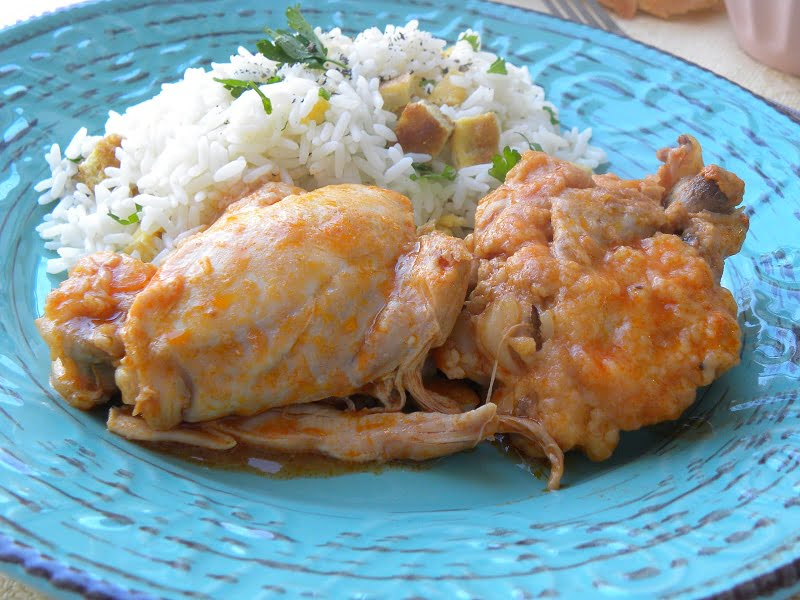 Kotopoulo kokkinisto stewed chicken and pilaf with omelet picture