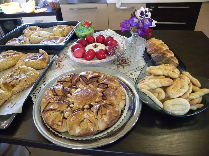 Table filled with Easter tsourekia, flaounes, koulourakia image