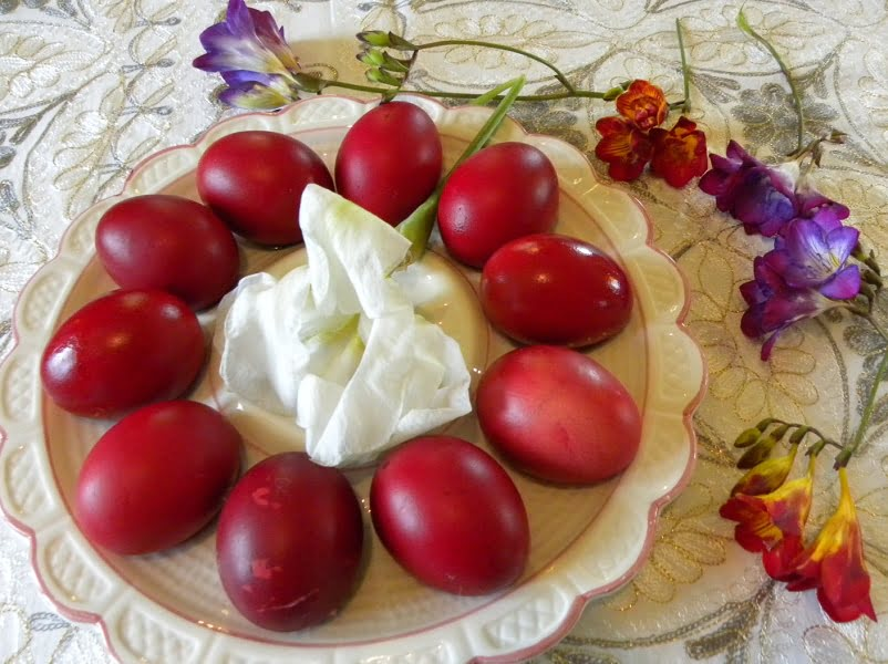 Dyed Easter red eggs with flowers image