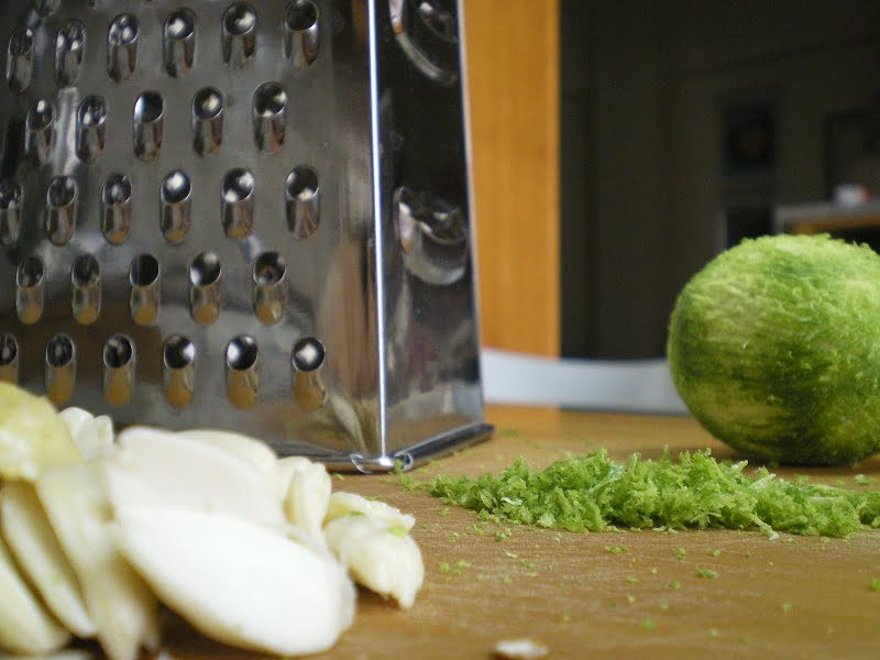 grated limes and blanched almonds image