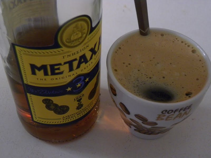 Espresso coffee with metaxa brandy image