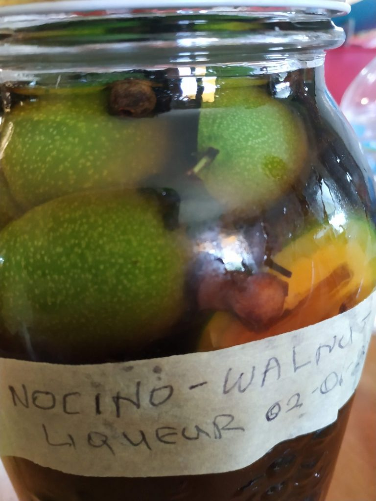 Steeping green walnuts in alcohol image