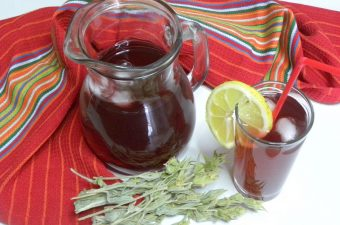 A jar and glass with tsai tou vounou image