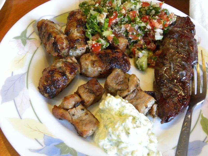 Liver, souvlaki and sheftalia with tzatziki and tambouleh image