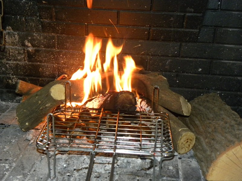 Roasting chestnujts on the fireplace image